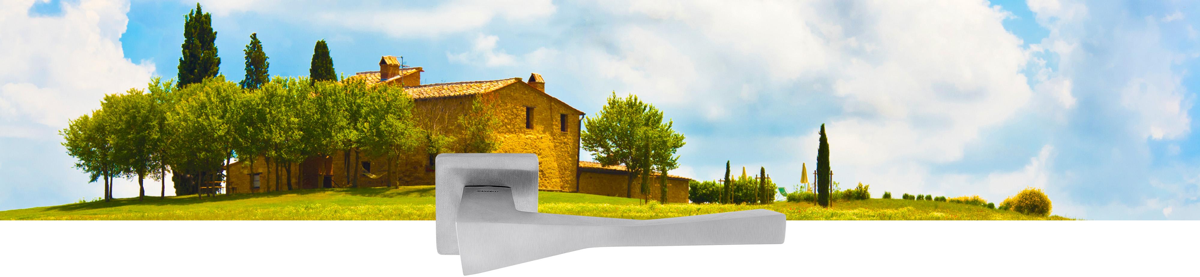 Sfeerafbeelding met Italiaanse cottage en deurkruk op rozet